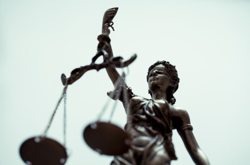 A scales of justice at an LA courthouse